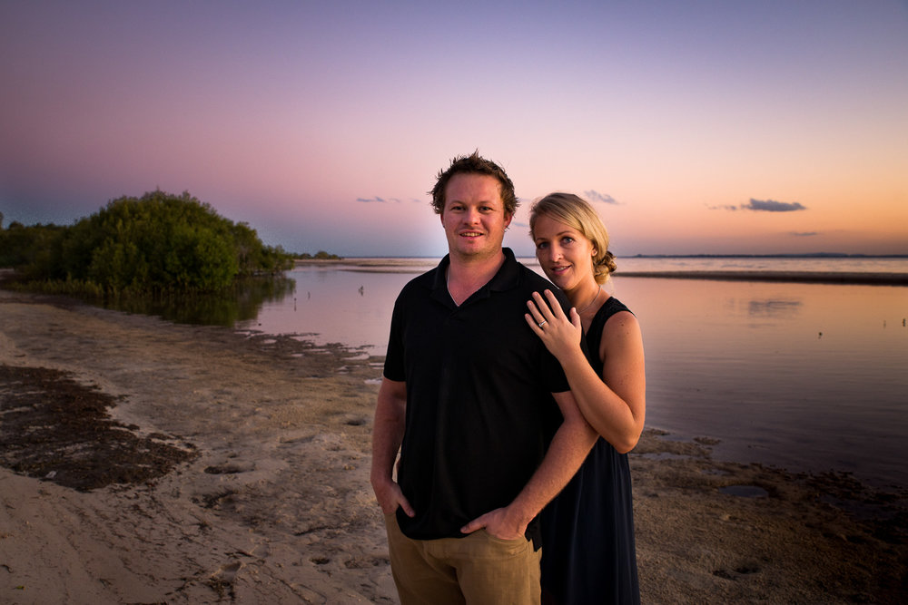 Engaged couple sunset at the beach, bribie island