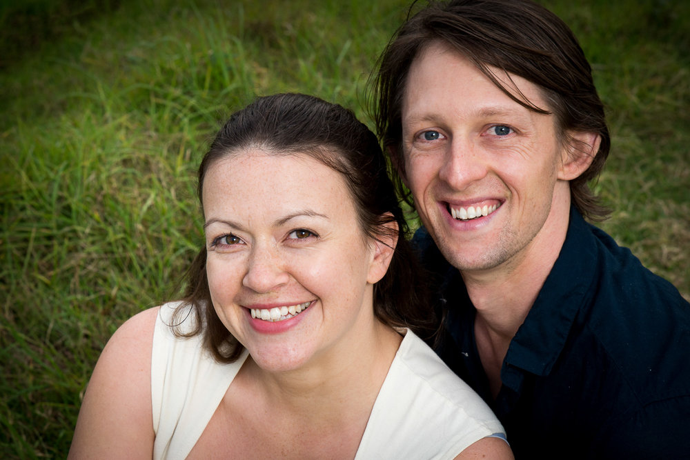 Tight crop of Becky and Dan sitting in long green grass
