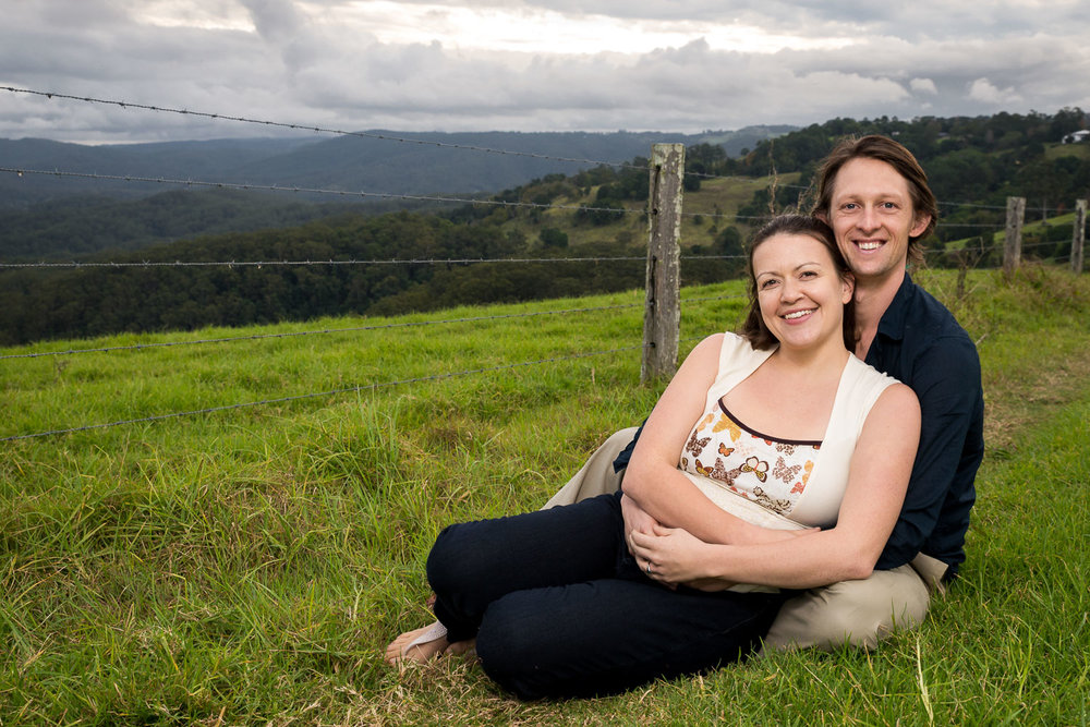 couple embracing with rolling hills in background