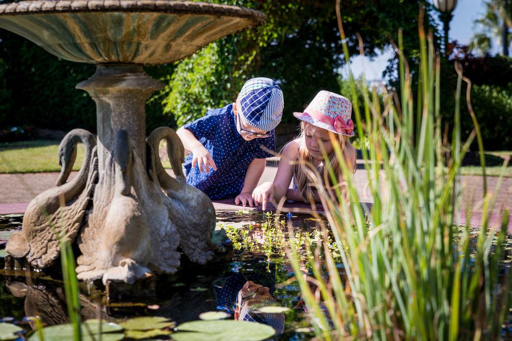 Kids playing in cottage garden pond
