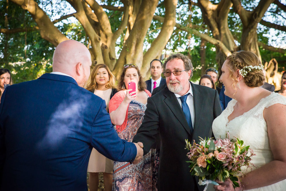 Phil the groom shaking hands with his soon to be father in law at Wirreanda Park in Buderim