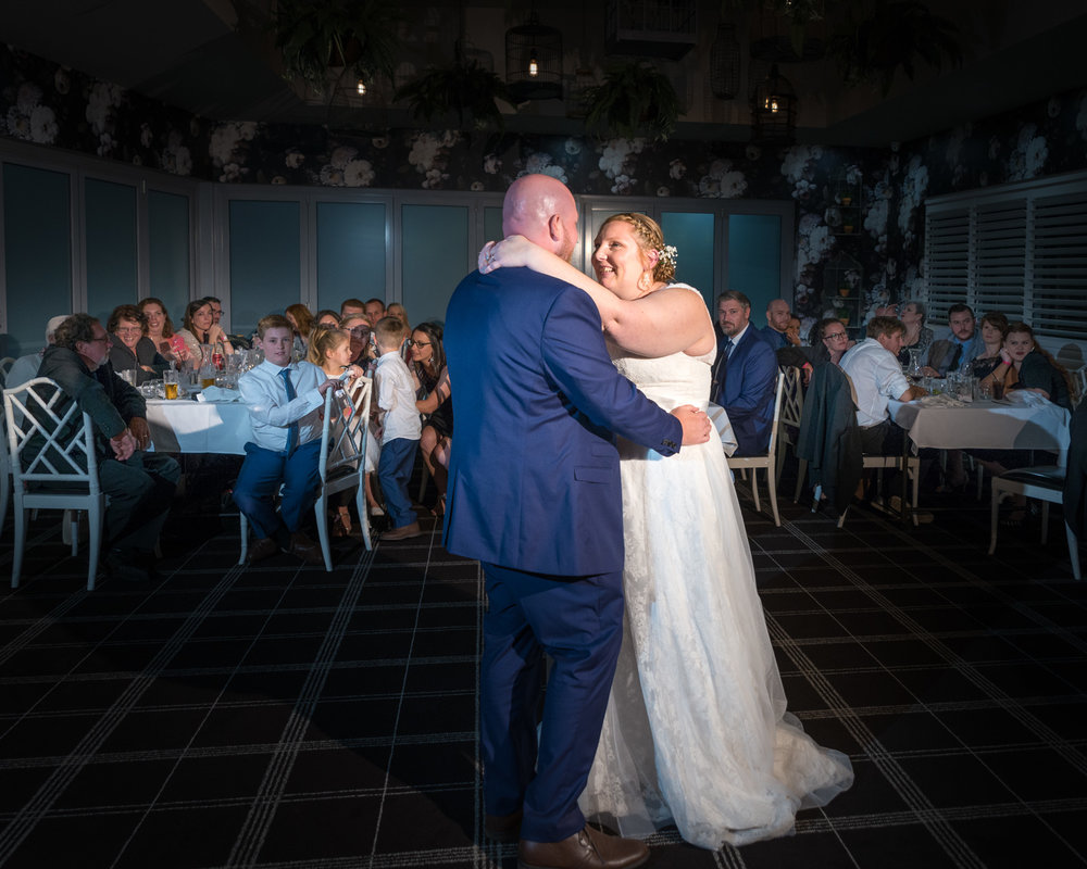 Bride and Groom first dance at the wedding reception at the Bird Cage Function Room at Parklands Tavern Caloundra