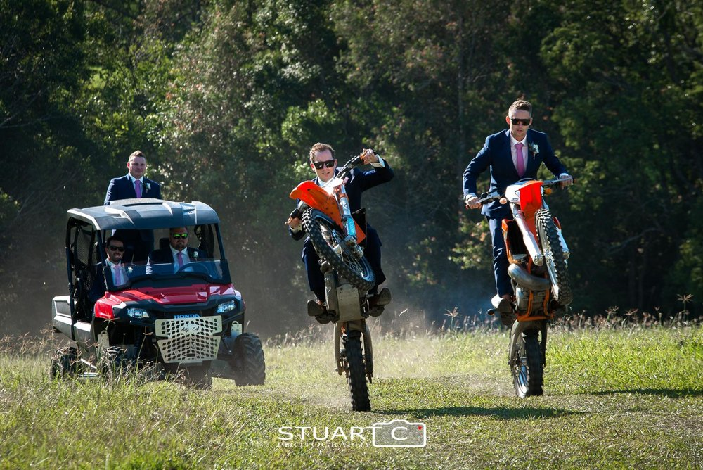 Groom and Groomsmen on motorbikes pulling wheely