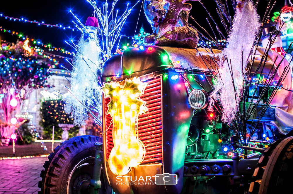 Vintage tractor with christmas lights at night