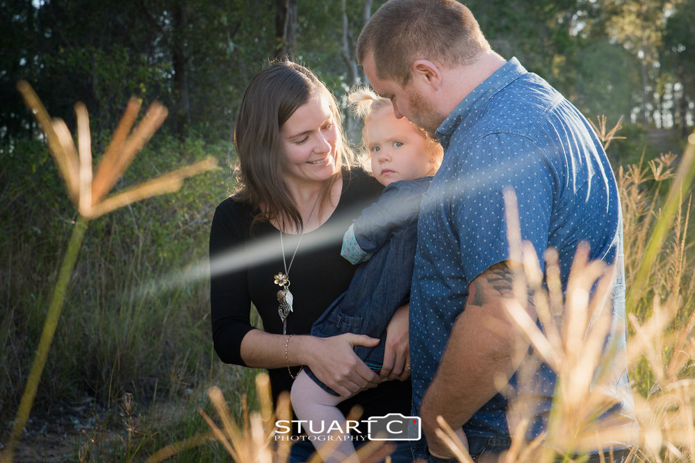 family in rural bushland setting with sun flare