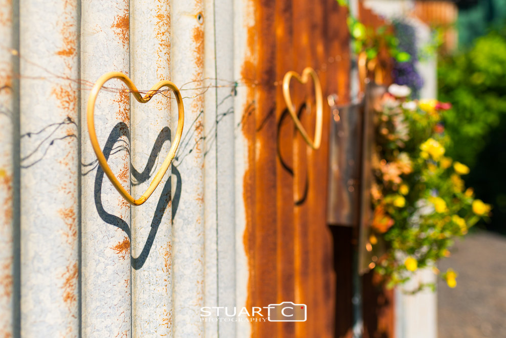 rustic wedding decorations timber hearts and flowers on rusted tin wall, elimbah home wedding near caboolture