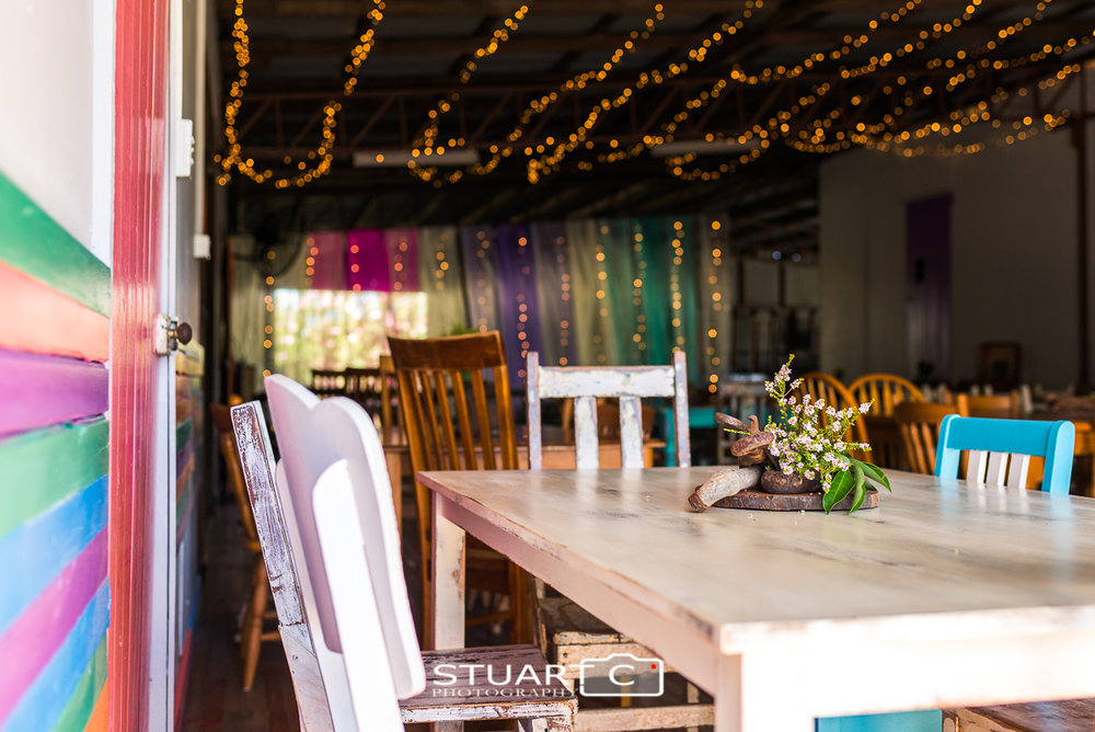 rustic home wedding at Elimbah with rustic furniture and fairy lights in old barn
