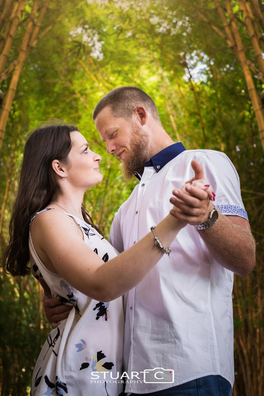 close up portrait of newly engaged couple, Casey and Gary, at Mt Cootha Botanical Gardens dancing in among the bamboo trees.