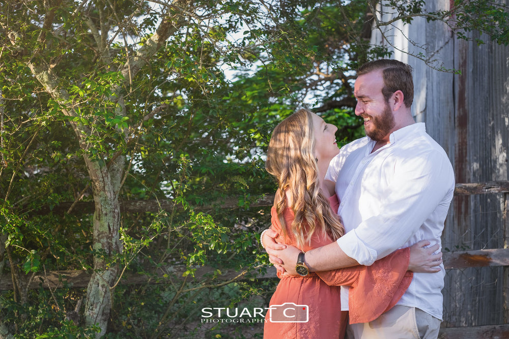 Portrait of newly engaged couple Jannika and Matt standing in Woodford