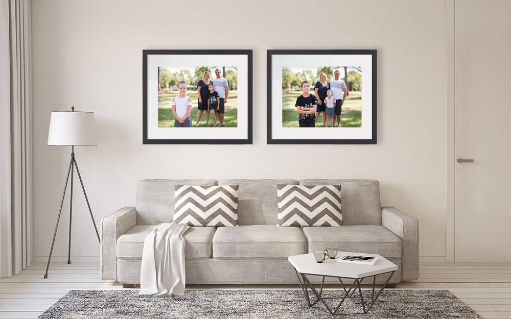 Framed family portraits on wall above couch