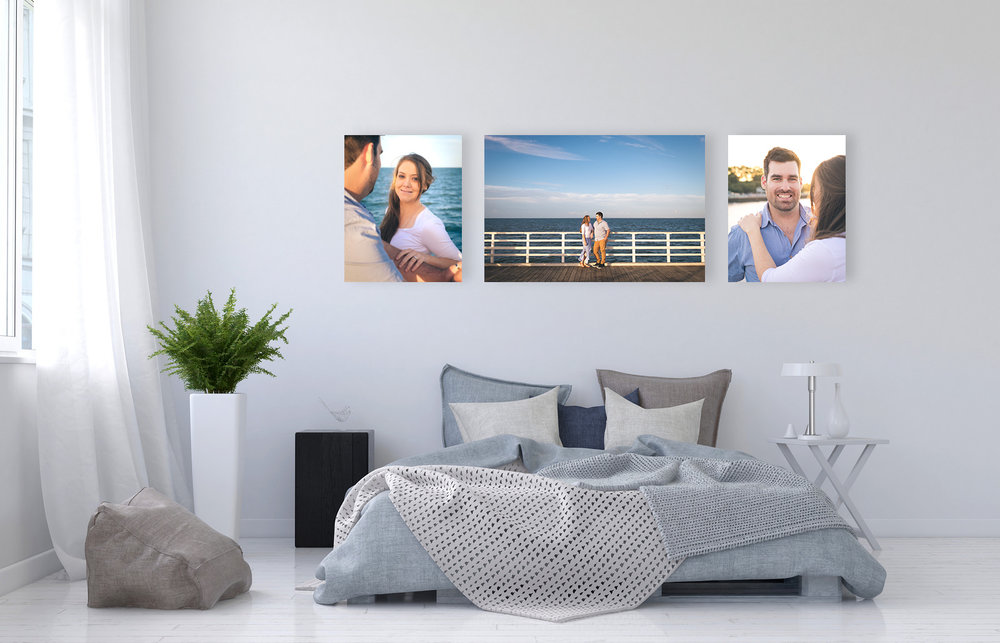 Trio of canvases on bedroom wall showing engagement photos