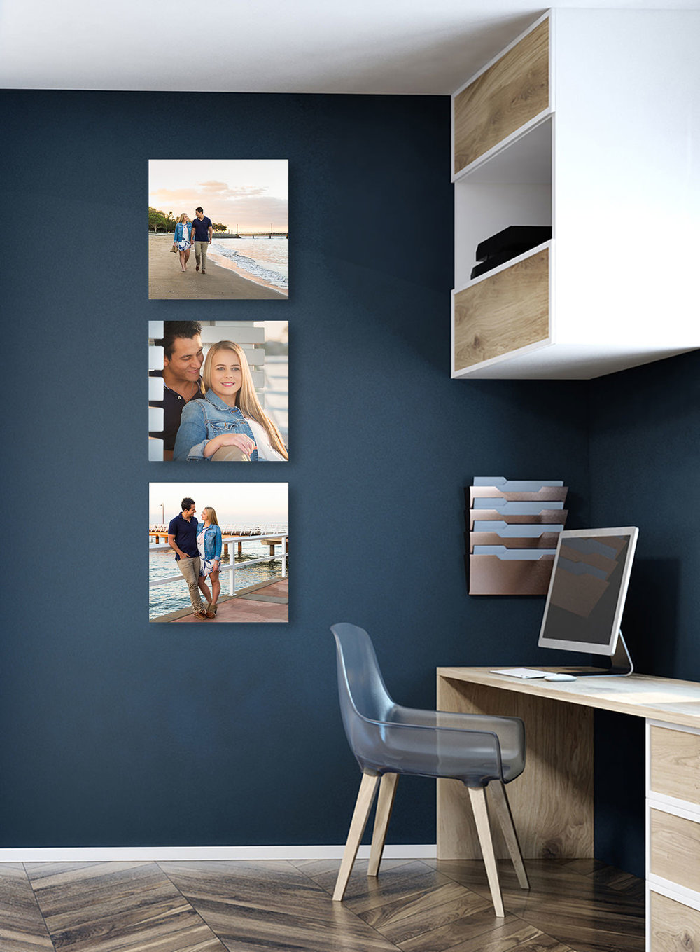 Trio of square canvases hung vertically in home office wall