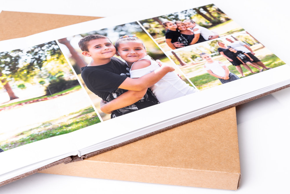Handmade photo album with page opened showing family photos