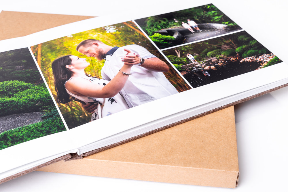 Handmade photo album with page opened showing engagement photos