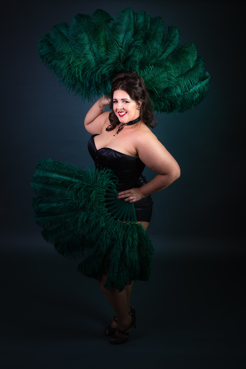 Cora Confetti burlesque performer with Bombshell Burlesque Academy, full length pose with green feather fans. Caboolture portrait photographer