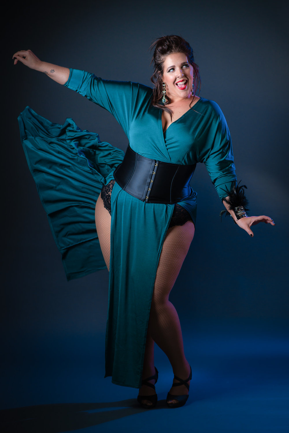 Full length pose of burlesque performer in long green dress.  Caboolture studio portrait photography