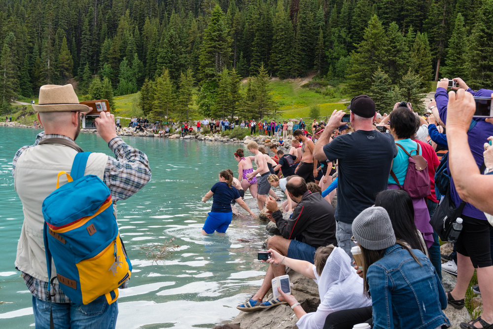 The somewhat famous Lake Louise polar bear dip.  As Lake Louise is glacier fed, the water is always cold.  This was the last Canada day activity I photographed.  There was a cake cutting event but who gives a shit about that?