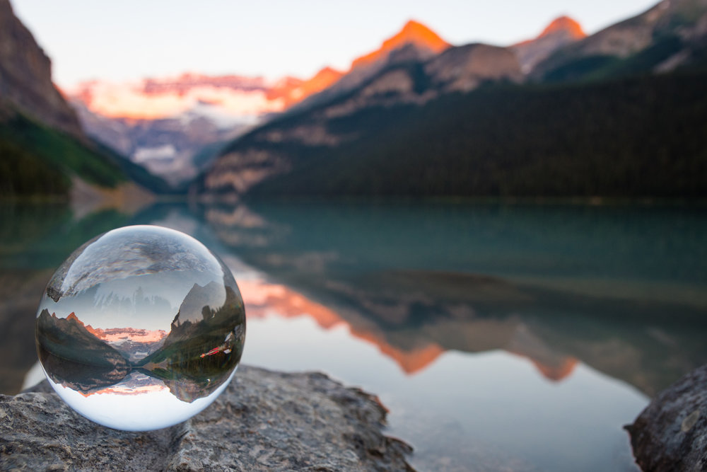 A photo I took in the morning showing Lake Louise and the Victoria glacier through the reflection of a glass ball. In some ways you could say this photograph has deeper meaning, Victoria glacier is a fragile environment, glaciers are melting away at an alarming rate and without the glacier Lake Louise would also not exist. The environment in the glass ball is fragile, as is the glass ball itself.