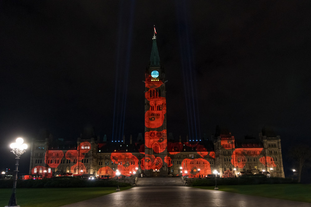 Parliament Hill, lit up for remembrance.