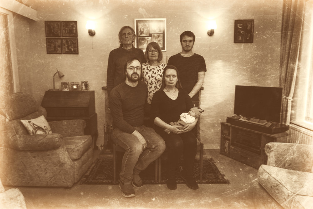 Old timely serious family photo