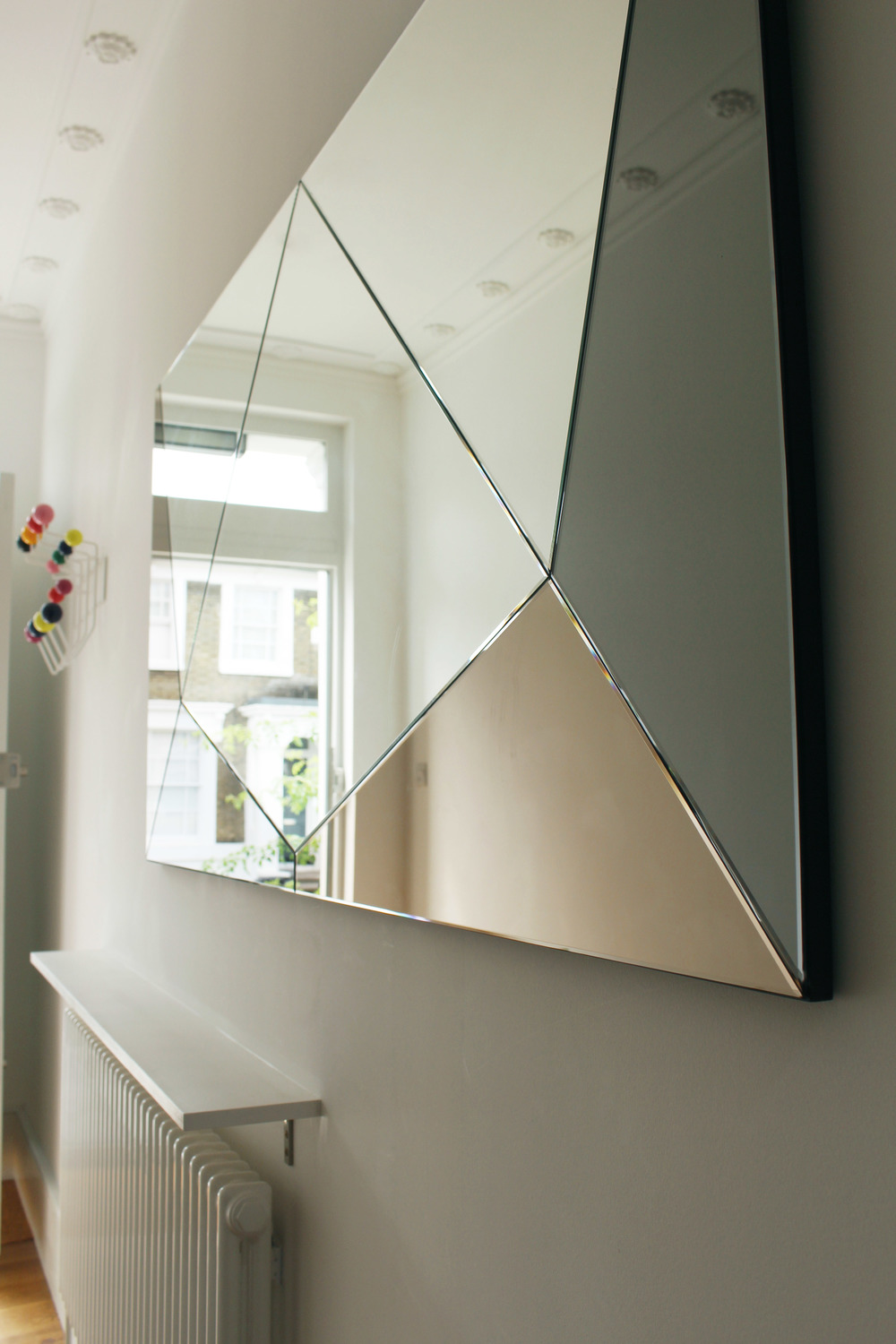 coloured geometric mirror commission hallway vitra hooks haidee drew.jpg