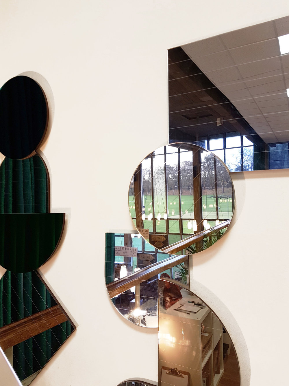 LAYER MIRRORS - Stunning Mid Century chandeliers hanging in the hall at Dulwich college and reflected in the Layer Mirrors in metallic's.