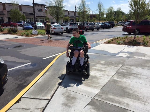 My nephew, Christopher, navigating the sidewalks of a new shopping center.