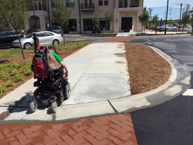 Christopher enjoying the wide new sidewalks in the new part of the city he is moving to.