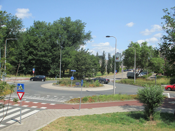 roundabout in the netherlands with protected bike lane through it.