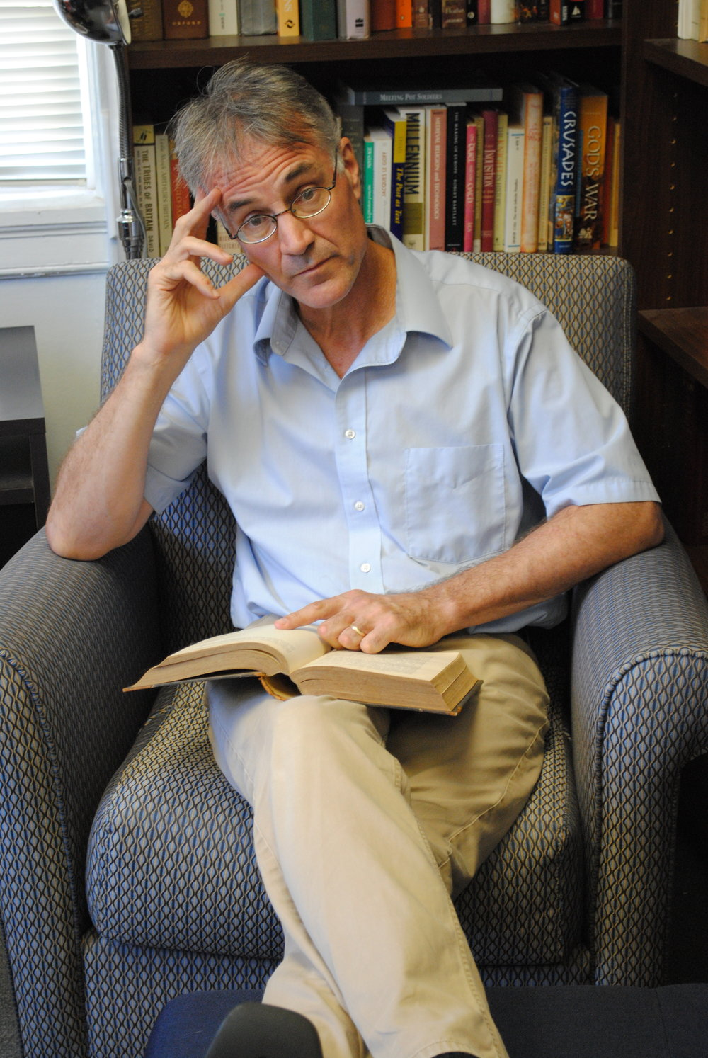 Sager reading in his office, 2017. Photo: Kris Petti