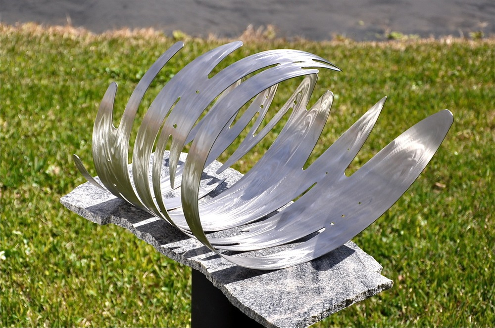 "'SO FAR SO GOOD' • 18"" high • stainless steel on a granite base"