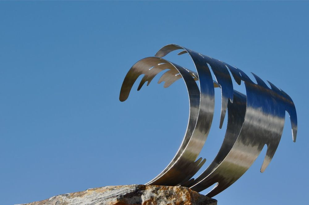 "'JOURNEY'S END' • 12"" high • stainless steel on a granite base"