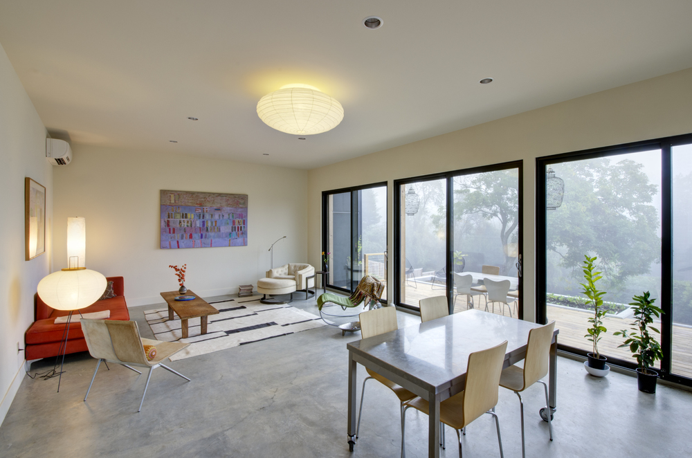 The Open Living Dining Kitchen Area Is Edged By Three Big Eight Foot