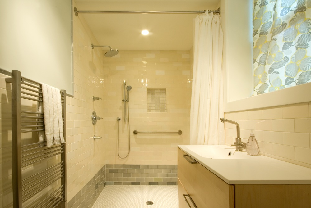 the lovely and airy bathroom in the basement unit is designed for with a no