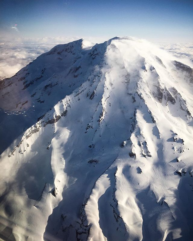 Last week on a flight out of Seattle, the Alaska Airlines pilot was inspired by the nice weather and decided to take a scenic detour to fly around Mt. Rainier. What a cool pilot! And mountain! Amazing!!! #iPhone.