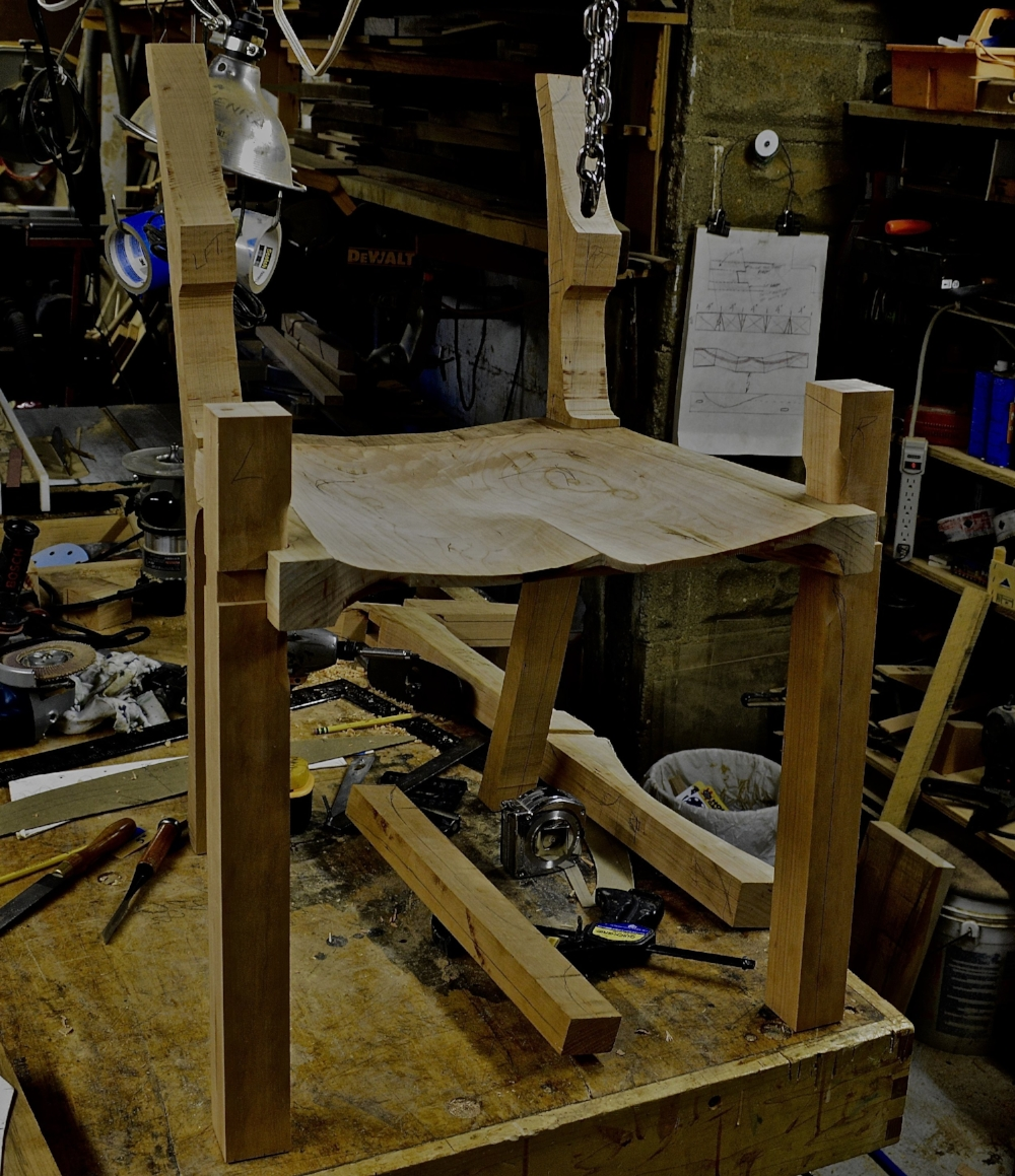 Today I carved the seats for both chairs and finished fitting the legs on the Sam Maloof styled low backed chair. The legs are dry fit, waiting for the crest rail to be fit and shaped. A lot more sanding yet.