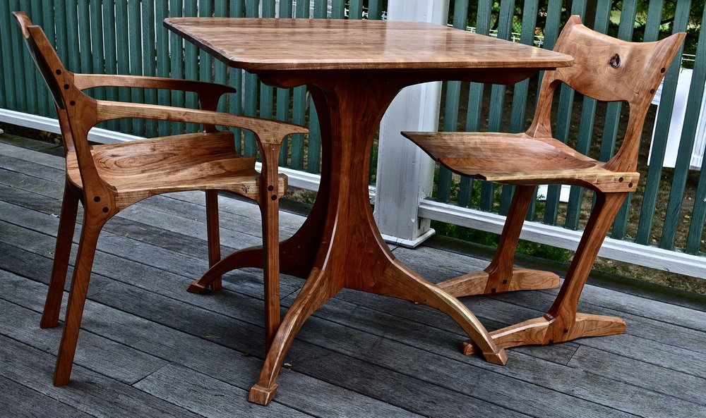 a Sam Maloof (low back occasional chair)- George Nakashima (conoid chair) mash in cherry w/ the cherry pedestal table