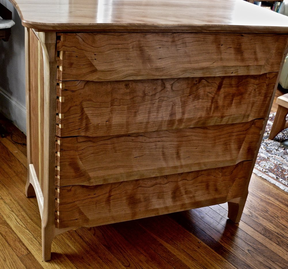 proud dovetails, carved drawer fronts