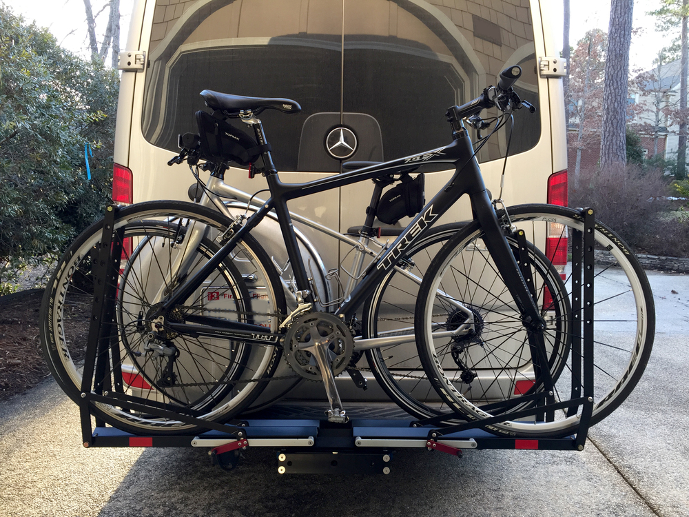 This shot angle is deceptive -- the bikes do not actually extend beyond the width of the van.