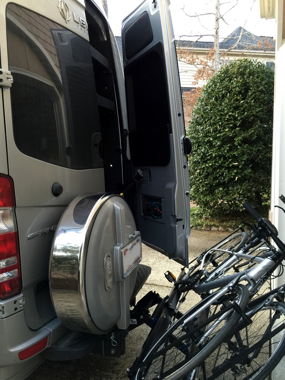 Access to rear storage compartment with bikes mounted and rack tilted down.  The right door will open completely only if you add a hitch extender.
