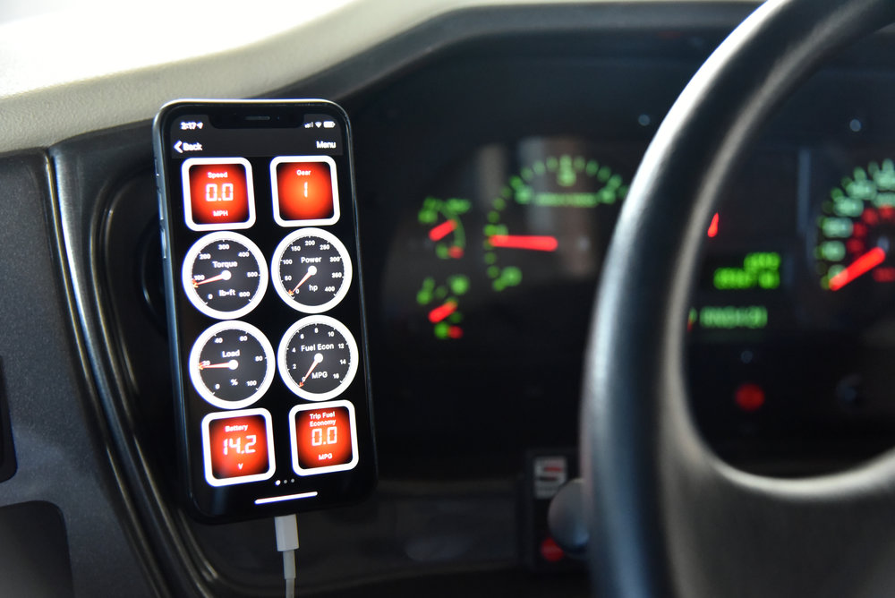 The OBDLink MX+ scanner is connected directly to an OBD-II port below the dashboard, and it automatically goes to sleep so as not to drain your chassis battery. When the engine is started, the adapter wirelessly connects automatically to a  dash-mounted  smartphone that graphically displays engine computer data in real time.