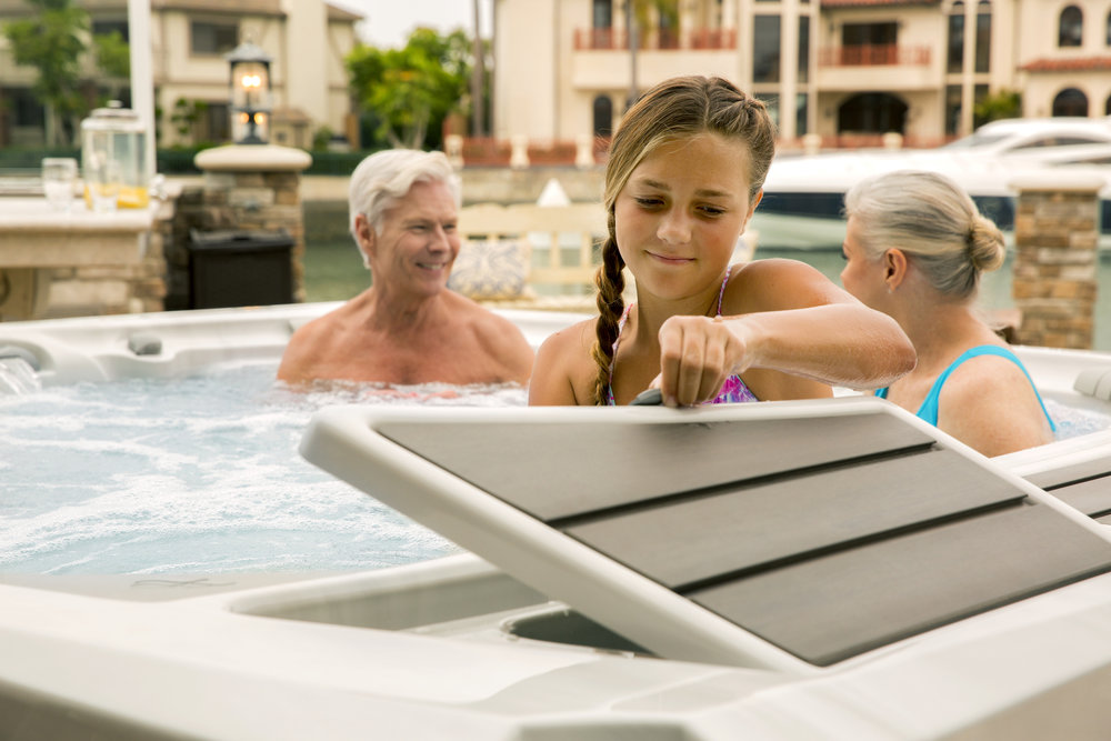 SunCooler™ and Conversation Deck - Integrated cold storage with illumination, removable lid matching exterior cabinetry and pump-assist drain for convenience. Also serves as additional seating for socializing out of the water without leaving the spa.