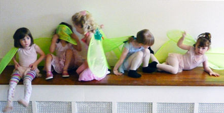 young girls right before dance recital with pixie wings