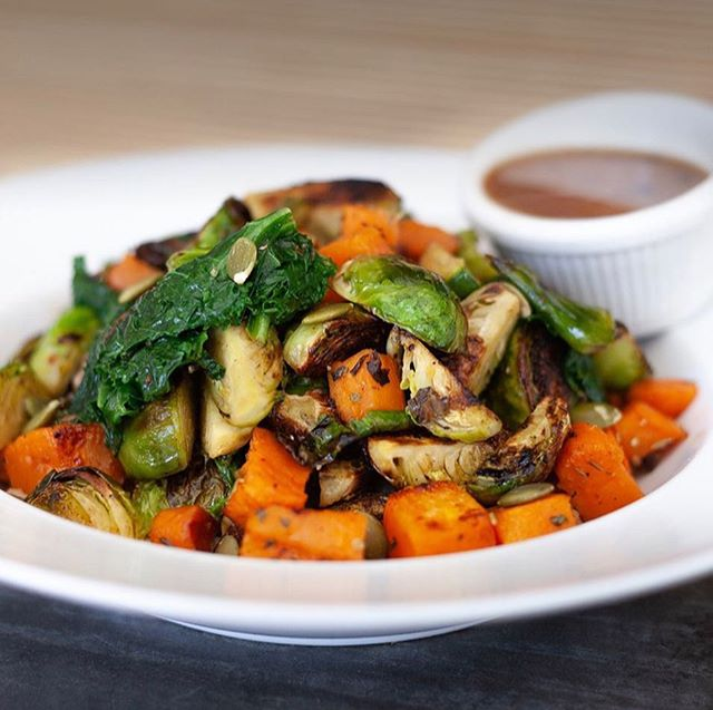 This is our Roasted Veggie Bowl with Farro and a lemon  vinaigrette dressing