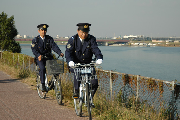 A pair of Omawari-san patrolling Tokyo