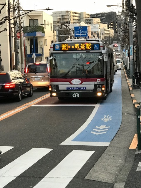 The new bright blue bike lane is even easier to identify here as it has been painted in block form.