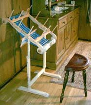 Use the floor stand to hold the loom while warping, even with a project on the other side.