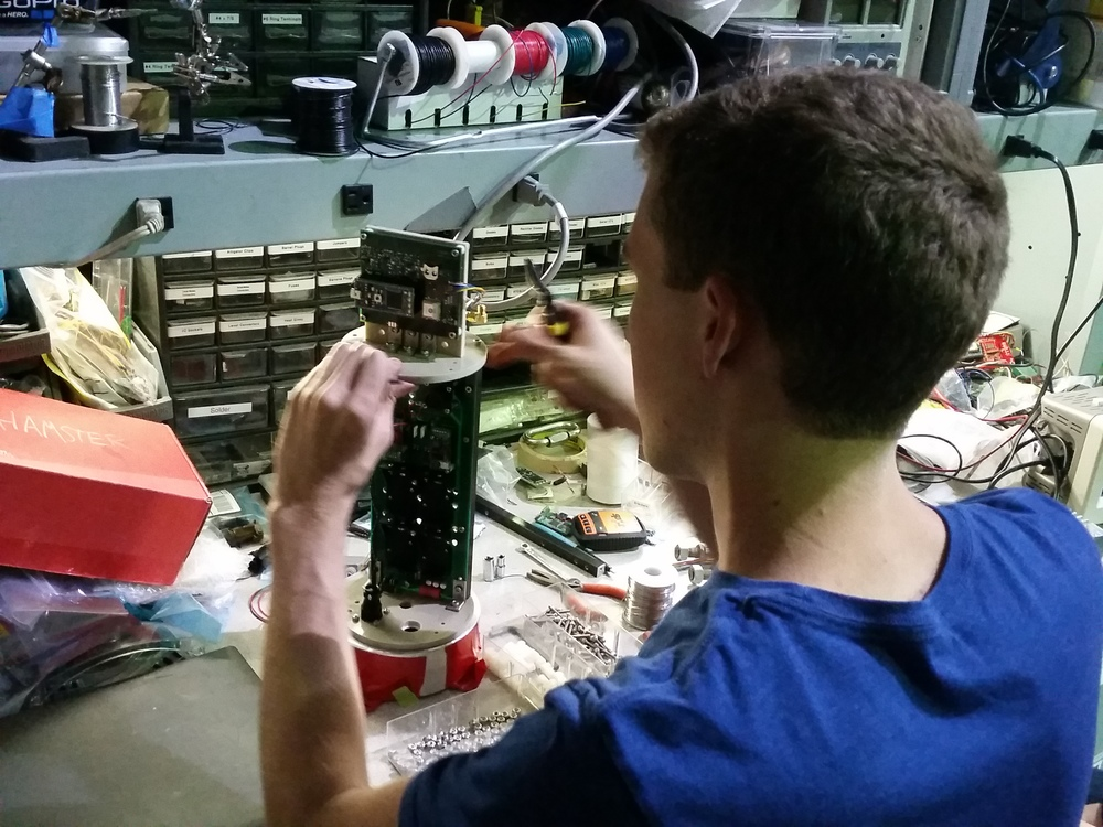 Carter assembling the avionics cartridge for flight