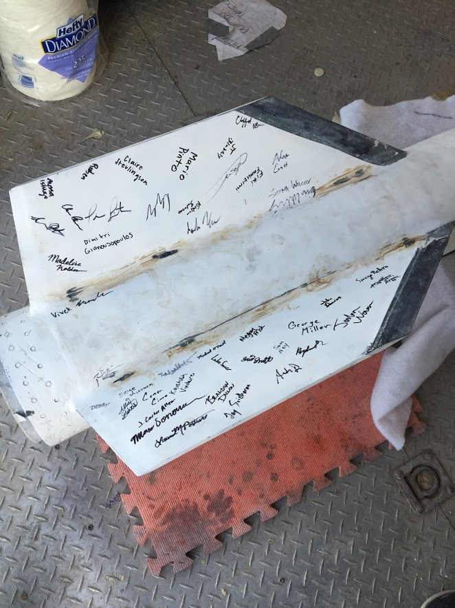 The whole lab signing the fins before launch day