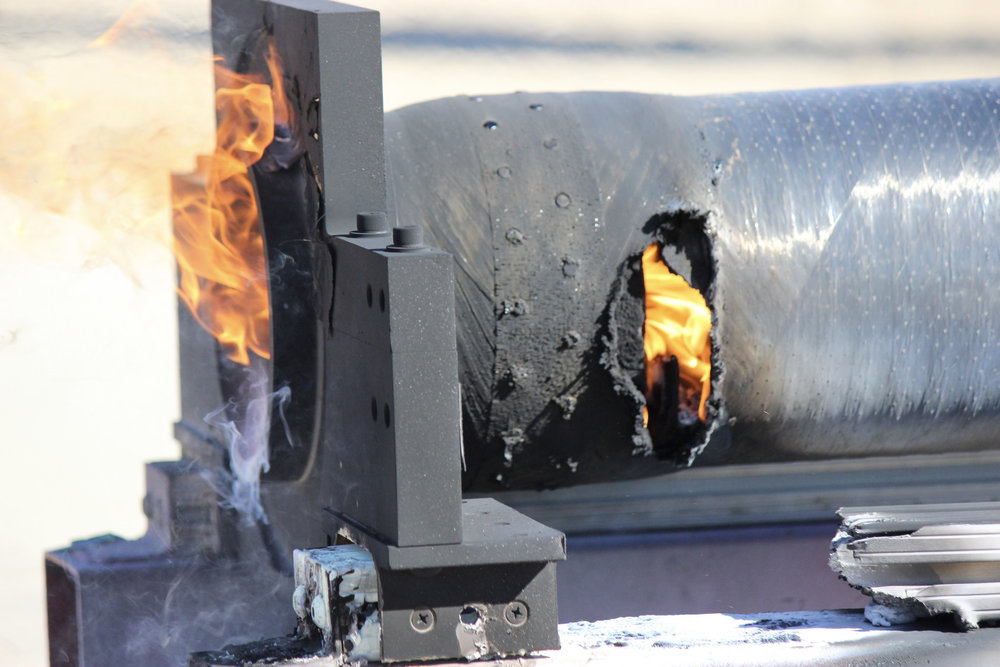 Aft end of the second static fire post-test, showing the location of the motor case burn-through.